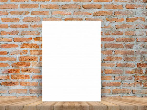 blank_white_poster_at_wood_table_with_brick_wall