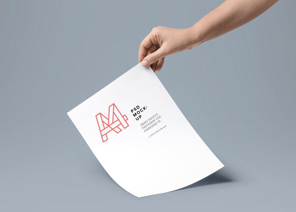 free_hand_holding_a4_paper_mockup