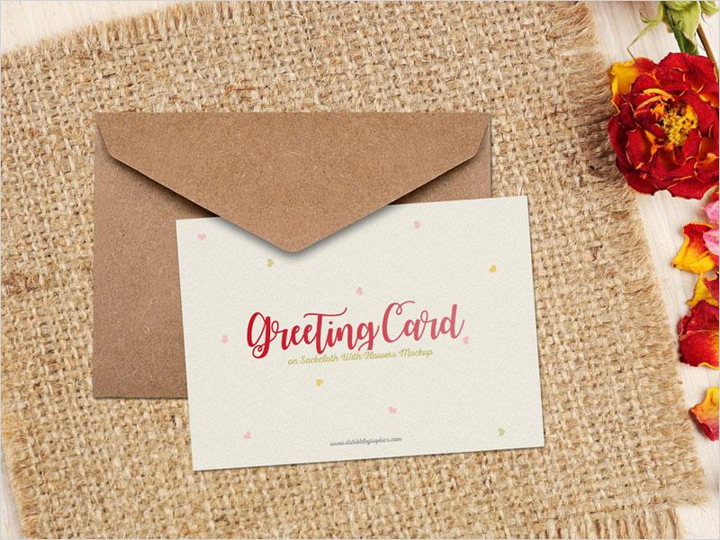 free_greeting_card_on_sackcloth_with_flowers_mockup_psd